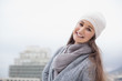 Smiling pretty brunette with winter clothes on posing