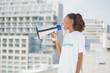 Cute volunteer woman shouting in megaphone
