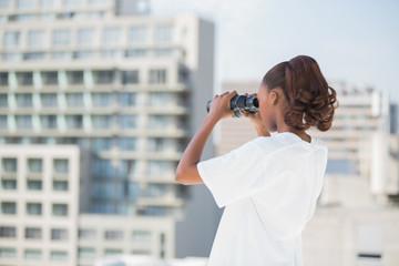 Volunteer woman using binoculars