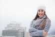 Cold cute brunette with winter clothes on posing