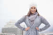 Pretty brunette with winter clothes on posing