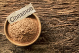 Ground cinnamon with a name tag