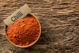 Chilli powder in a rustic wooden bowl