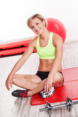 Smiling woman at gym