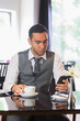 Businessman having coffee in restaurant