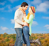 Happy young couple spending time outdoor in park