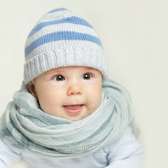 Laughing baby - adorable face, child in blue