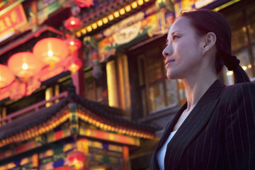 Businesswomen with Chinese architecture in background.