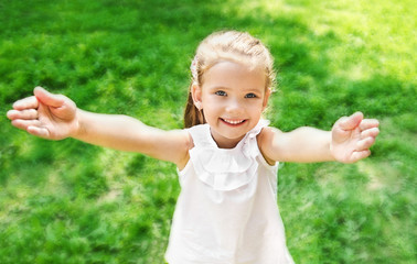 Cute smiling little girl giving her hands