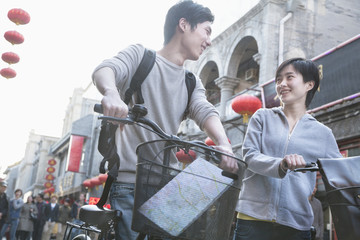 Young man and woman with bicycles and map.