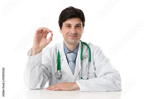 doctor shows a pill