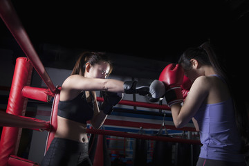 Two female boxers boxing in the boxing ring in Beijing, China