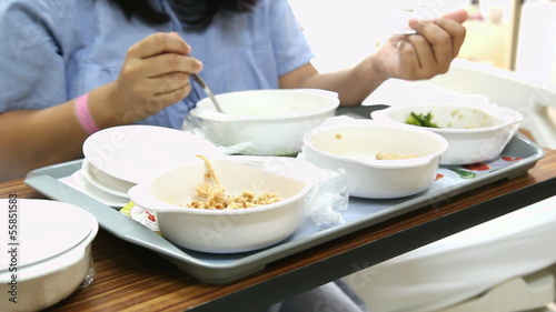 Patient girl have soft special meal on bed in hospita