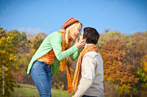 Sweet young couple have a fun in park.