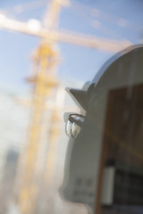 Close-up of reflection of architect on construction site