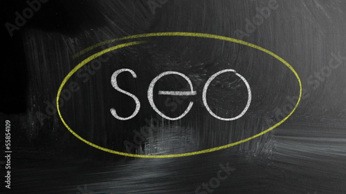 Seo Handwritten With White Chalk On A Blackboard