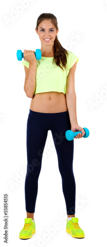 Beautiful young girl doing exercises isolated on white