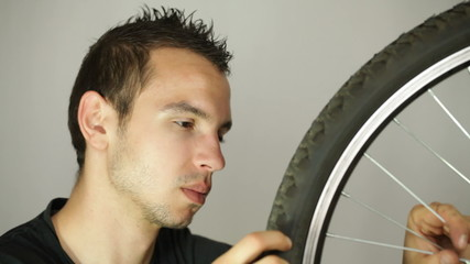 Closeup of man repairing bicycle wheel