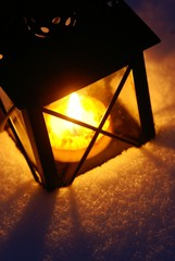 Detail of lantern on snow