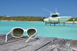 Sunglasses on the wooden pier. Great Exuma, Bahamas