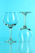 Two glasses on light blue background