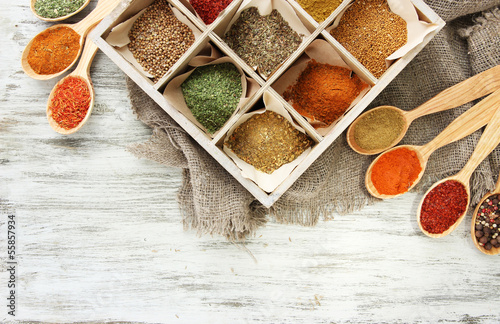 Fotobehang Kruiden 2 Assortment of spices in wooden spoons and box,