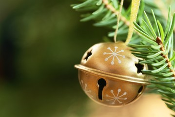 Jingle bell on Christmas tree with copy space.