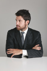 Portrait of a young businessman looking to the side.