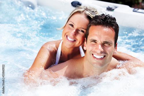 Leinwanddruck Bild Happy couple in jacuzzi.