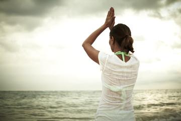 Woman doing yoga on Punta Cana beach.