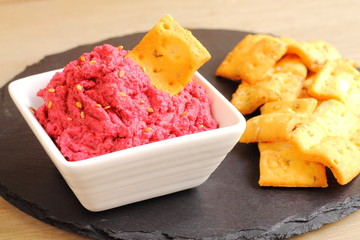Beetroot and chickpea hummus dip with crackers