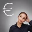 Business woman thinking about money with euro sign near her on g