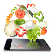 Vegetables and tablet, isolated. Recipes application concept.