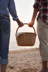 Young Couple Holding Picnic Basket