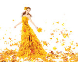 Autumn woman in yellow dress of maple leaves