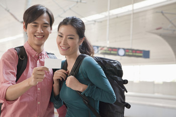 Young Couple Checking Their Train Ticket