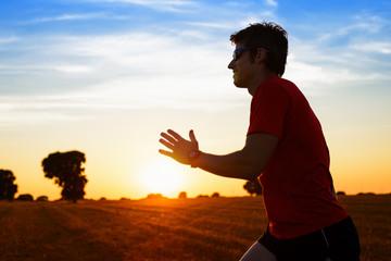 Man running on summer sunset