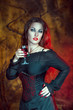 Beautiful halloween woman with glass of wine