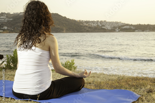 Lotus position on the seaside at sunset