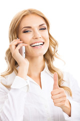 Businesswoman with cellphone, showing thumbs up
