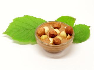 Hazelnut chocolate in glass bowl with leaf