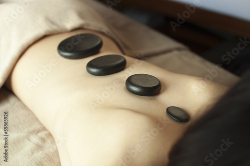 Young Woman's Back with Stones of Progressing Size