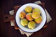 Organic peaches on  a platter in the country