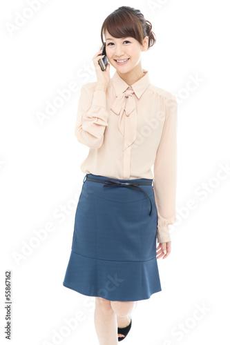 Beautiful asian business woman using a cellular