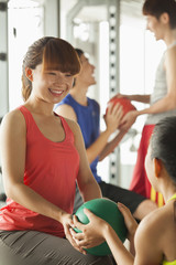Group of young people exercising in the gym