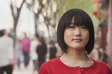 Young Woman smiling and looking at camera