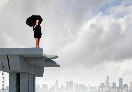 Businesswoman on bridge