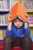 Unhappy Boy with Book