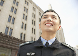 Police Officer Smiling, low angle view