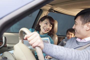 Family sitting in car, Beijing